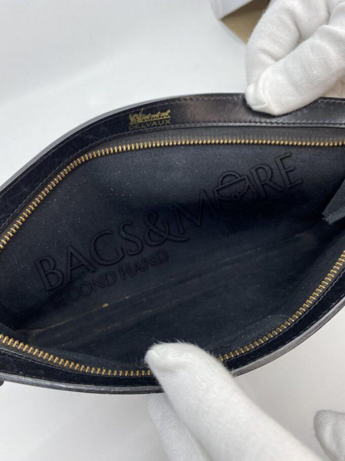 Delvaux Clutches zwart met goudkleurige accenten
